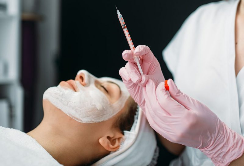 beautician with syringe in hands botox injection