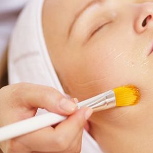 woman-being-applied-a-facial-mask