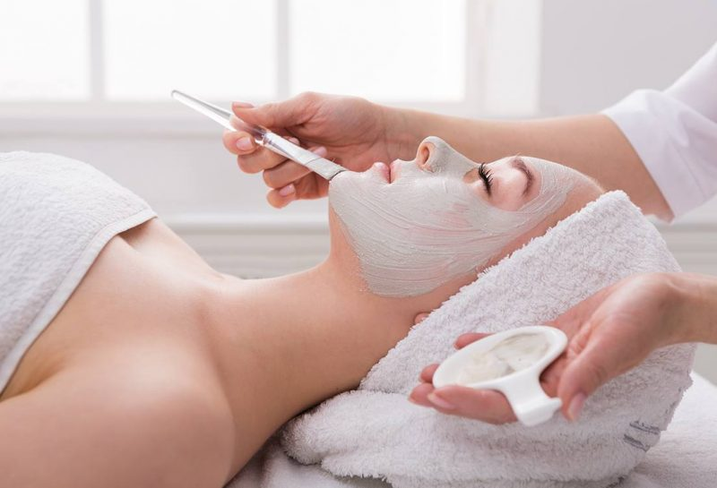 woman-gets-face-mask-by-beautician-at-spa